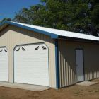 Summit garage with soffit finishing and custom doors.