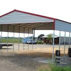 Grand carport with gable end sidewall kits.